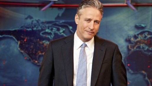 Jon Stewart wearing a suit and tie
