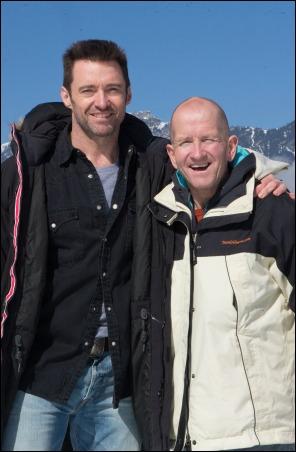 Hugh Jackman, left, poses with Eddie Edwards on the set of EDDIE THE EAGLE.