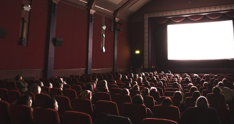 A crowd of people in a movie theater