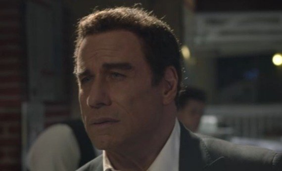 John Travolta wearing a suit and tie