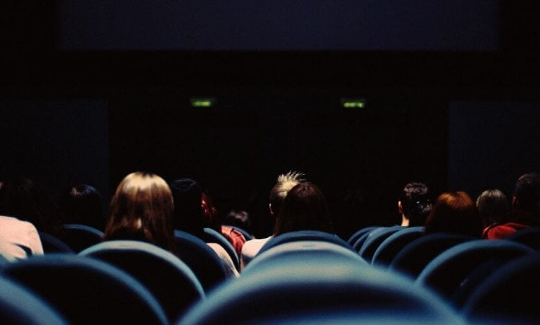 A crowd of people watching a movie